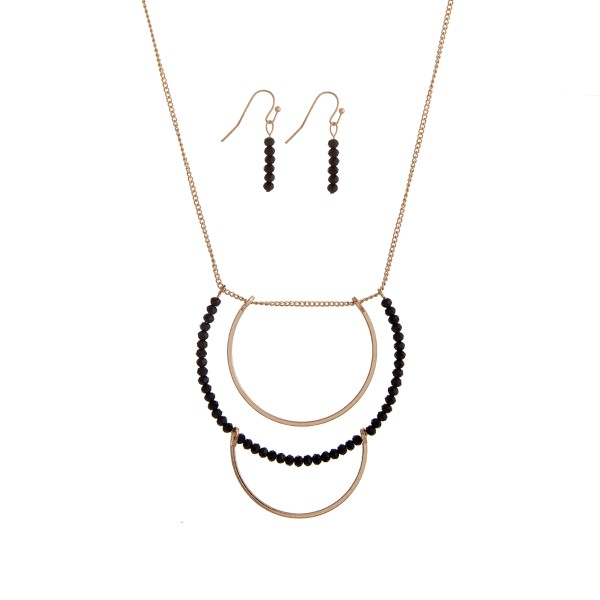 Wholesale gold necklace set displaying layered half rings black bead accents
