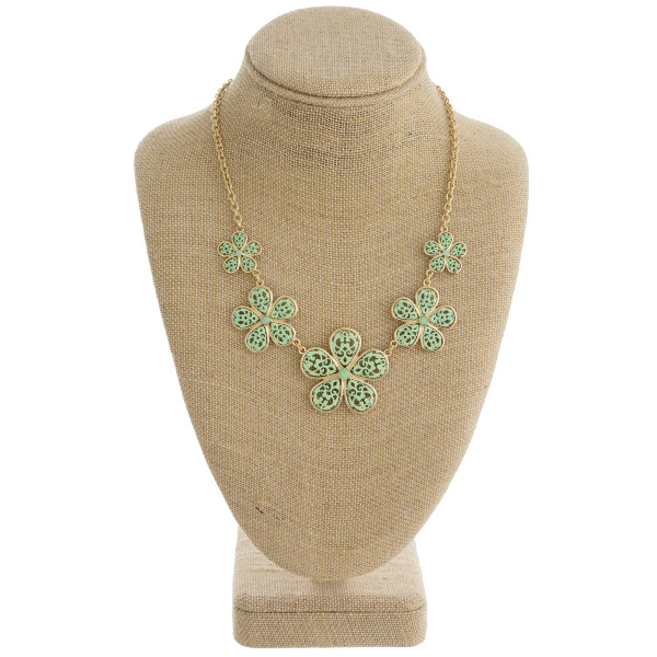 Wholesale gold necklace set displaying mint green filigree flowers