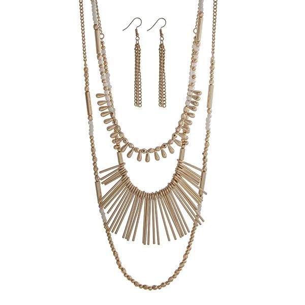 Wholesale gold layering necklace set displaying white gold beads metal fringe