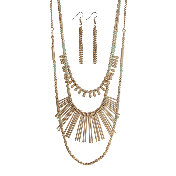 Wholesale gold layering necklace set displaying mint gold beads metal fringe