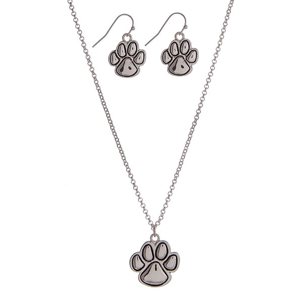 Wholesale silver necklace set displaying small paw print pendant matching earri