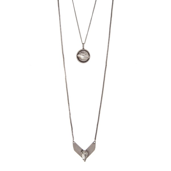 Wholesale burnished silver layering necklace displaying disk chevron clear caboc
