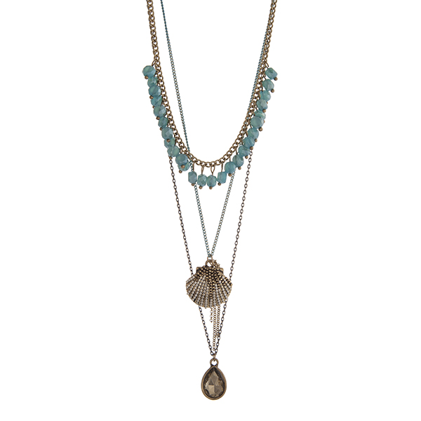 Wholesale gold layering necklace displaying turquoise dangling beads seashell ch
