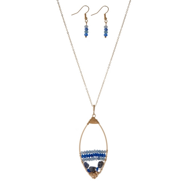 Wholesale gold necklace set displaying open teardrop wire wrapped blue beads