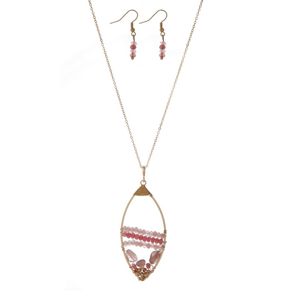 Wholesale gold necklace set displaying open teardrop wire wrapped pink beads