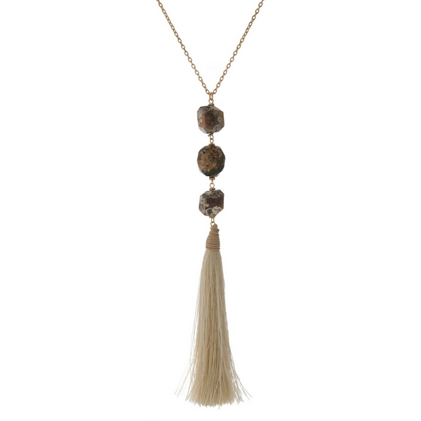 Wholesale gold necklace displaying three brown natural stone beads ivory fabric