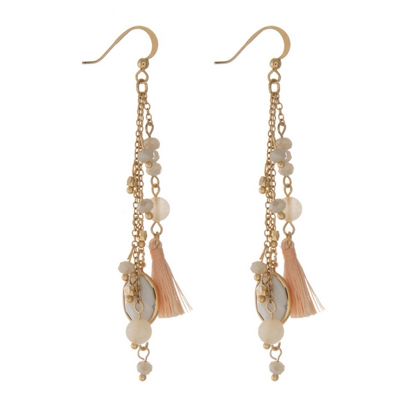 Wholesale gold fishhook earrings displaying chain tassels ivory beads howlite st