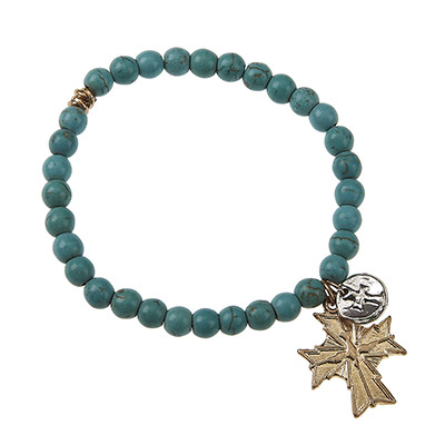 Simulated natural turquoise stone beaded stretch bracelet featuring a small round silver tone cross stamped pendant and a gold tone cross charm.