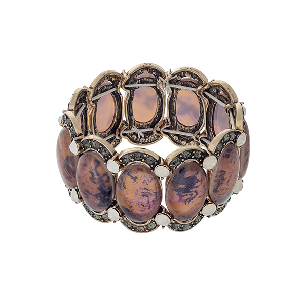 Wholesale burnished gold stretch bracelet displaying orange oval stones black di