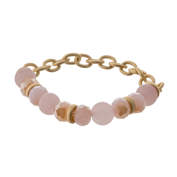 Wholesale matte gold stretch bracelet displaying pink peach natural stone beads