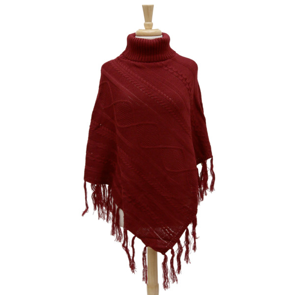 Wholesale knit turtleneck poncho fringe tassels along bottom hem cable knit patt
