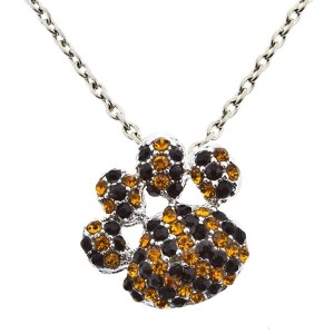 """20"""" silver tone necklace with a 1"""" paw pendant encrusted with yellow and black rhinestones."""