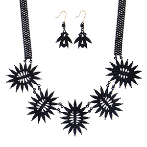 "18"" Black coated necklace featuring a floral style focal with matching 2"" fishhook style earrings."