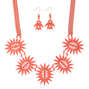 "18"" Peach coated necklace featuring a floral style focal with matching 2"" fishhook style earrings."