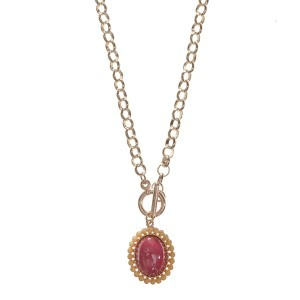 "20"" gold tone chain link toggle necklace featuring a 1"" FSU colored pendant"