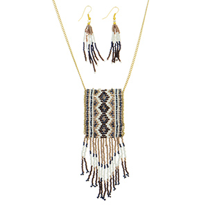 "Gold tone necklace set featuring brown, ivory, navy blue, and tan seed bead decor with fringe bottom. Approximately 26"" in length."