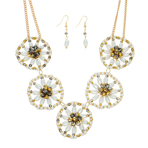"""Gold tone necklace set featuring five ivory faux pearl flowers with grey bead decor. Approximately 16"""" in length."""