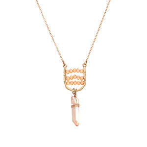 "Burnished gold tone necklace featuring a u-shaped casting with peach glass beads and a wire wrapped natural stone. Approximately 28"" in length."