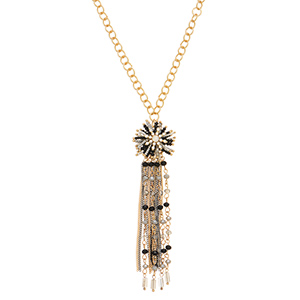 "Gold tone necklace featuring a black and gray seed bead pendant with metal and glass bead fringe decor. Approximately 30"" in length."