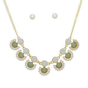 "Multiple strand gold tone necklace set featuring green and opal round stones with faux ivory pearl accents. Approximately 16"" in length."