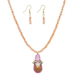 "Gold tone necklace set featuring peach beads with a pink and topaz stone pendant with rhinestone accents. Approximately 16"" in length."