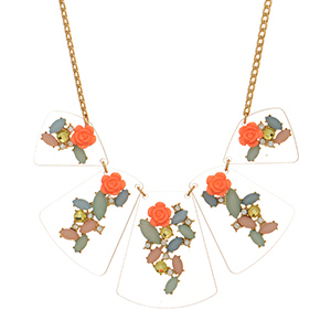 "Gold tone necklace featuring clear wedges with orange flowers and multicolored stone decor. Approximately 18"" in length."