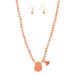 "Gold tone necklace set featuring topaz beads with a peach teardrop shaped cabochon and tassel accent. Approximately 15"" in length."