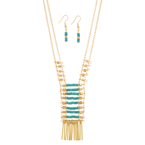 "Gold tone double strand necklace set featuring metal and turquoise beads with metal fringe decor. Approximately 33"" in length."