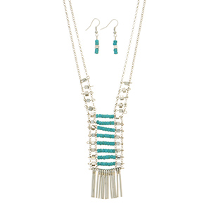 "Silver tone double strand necklace set featuring metal and turquoise beads with metal fringe decor. Approximately 33"" in length."