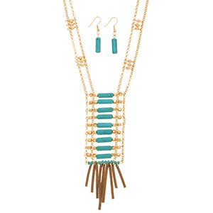 "Gold tone double strand necklace set featuring metal beads and turquoise stone bars with brown faux leather fringe decor. Approximately 34"" in length."