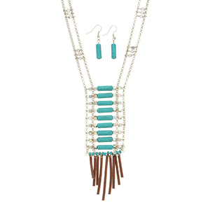 "Silver tone double strand necklace set featuring metal beads and turquoise stone bars with brown faux leather fringe decor. Approximately 34"" in length."