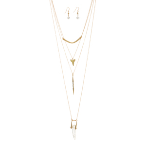 "Gold tone layering necklace set featuring a curved bar, a cream sharks tooth, a rhinestone pendant, and a pendant with a clear natural stone. Approximately 28"" in length."