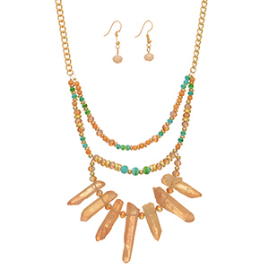 "Gold tone necklace set featuring peach and turquoise beads with a peach natural stone focal. Approximately 18"" in length."