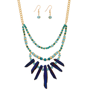 "Gold tone necklace set featuring turquoise and teal beads with a royal blue natural stone focal. Approximately 18"" in length."