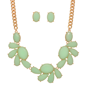"Gold tone necklace set featuring large mint green multiple shaped cabochons. Approximately 14"" in length."