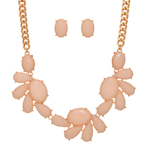 "Gold tone necklace set featuring large pale pink multiple shaped cabochons. Approximately 14"" in length."