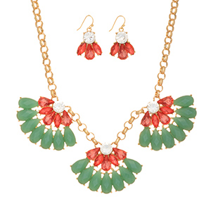 "Gold tone necklace set featuring three rose pink and mint green half floral cabochons. Approximately 16"" in length."