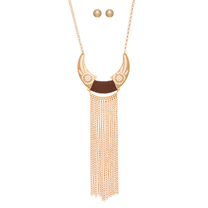 "Gold tone necklace set featuring a bohemian style crescent pendant wrapped with brown faux leather and metal fringe accents. Approximately 25"" in length."