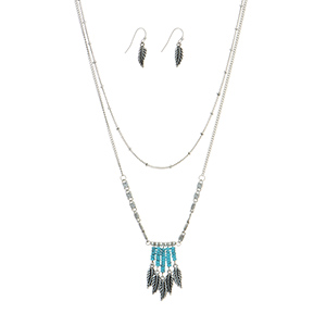 "Burnished silver tone layering necklace set featuring turquoise beaded fringe with hanging leaves. Approximately 18"" in length."