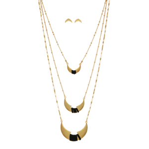"Gold tone layering necklace set featuring three crescents wrapped with black faux leather cord. Approximately 24"" in length."
