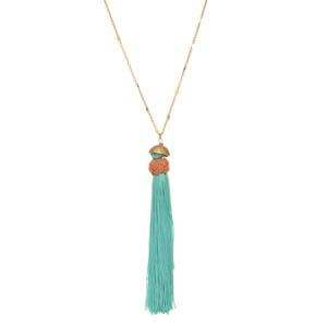 "Matte gold tone necklace featuring a mint green tassel with braided peach cord. Approximately 25"" in length."