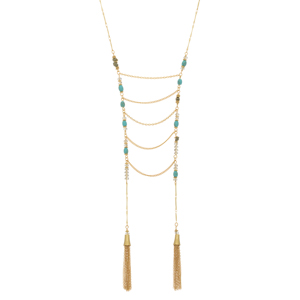 "Gold tone necklace featuring turquoise and pyrite natural stones with metal drapes and tassels. Approximately 36"" in length."