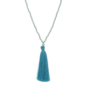 "White beaded necklace featuring a blue fabric tassel. Approximately 24"" in length."
