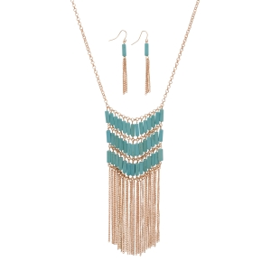 "Gold tone necklace set featuring a turquoise stone chevron pattern with metal fringe. Approximately 27"" in length."