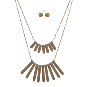 "Worn gold tone layering necklace set featuring pointed metal bars. Approximately 21"" in length."