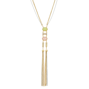 "Two tone necklace featuring pink and green stones and a champagne cabochon with metal tassel accents. Approximately 27"" in length."