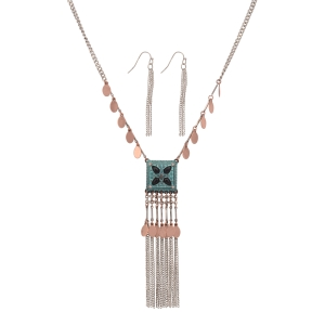 "Burnished silver tone necklace set featuring hanging copper tone disk and a patina pendant with black stones and metal fringe. Approximately 24"" in length."