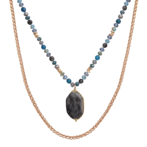 "Gold tone layering necklace featuring blue and gray beads with a gray wire wrapped natural stone pendant. Approximately 38"" in length."
