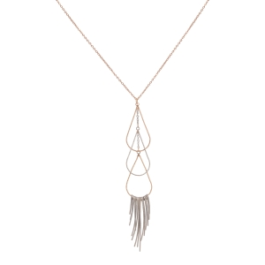 "Gold tone necklace featuring a two tone teardrop shaped pendant with metal stick accents. Approximately 30"" in length."
