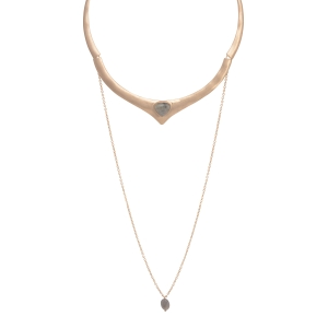 Worn gold tone choker featuring a labradorite triangular stone focal with a hanging chain and stone bead.